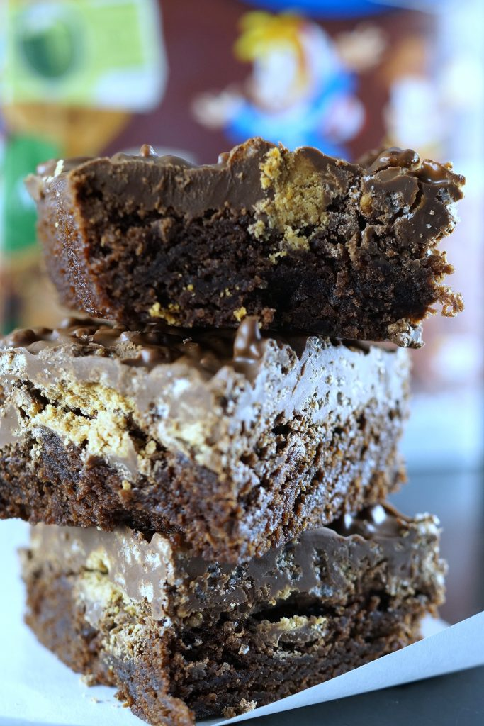 Parties are a little more fun when you serve peanut butter cocoa rice krispies brownies for dessert. Spread #TidingsAndTreats this holiday season ad