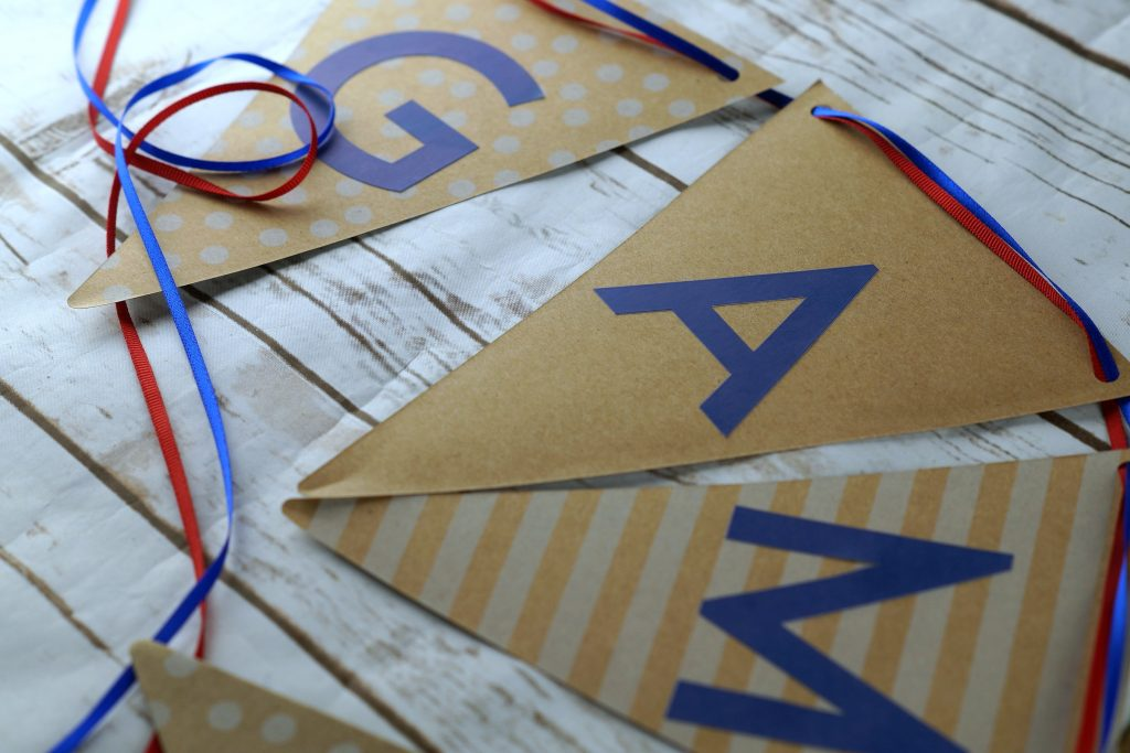 Follow this tutorial and learn how to make your own DIY game day garland for your big game party in under 10 minutes! #MegaGame #ad