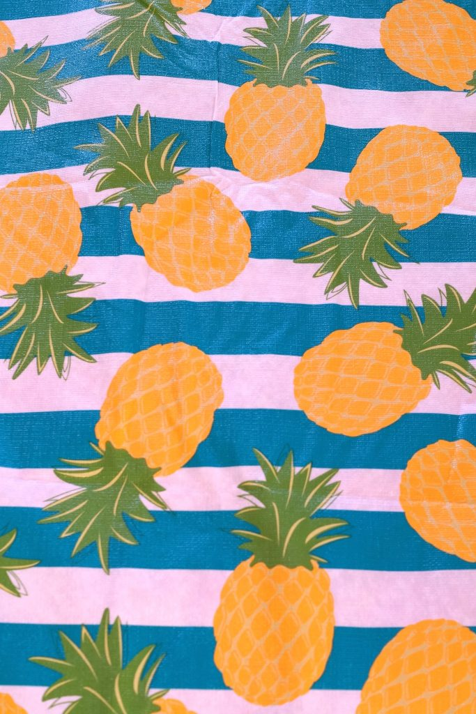 Learn how to sew a picnic blanket from a vinyl tablecloth. This easy beginner sewing project can be completed in 30 minutes. #ad #PurexCrystalFresh