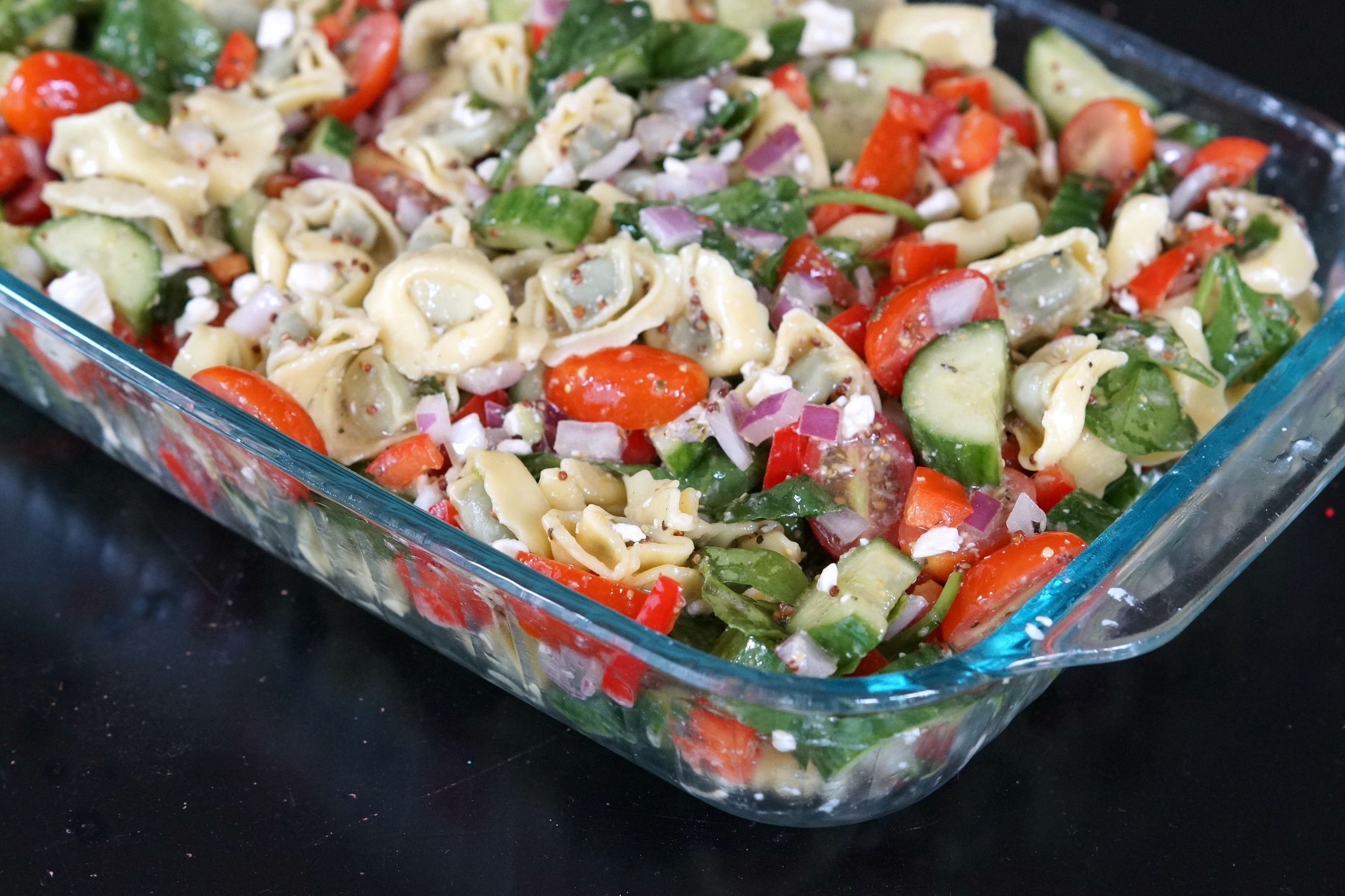 Looking for the perfect dish for a pot luck that doesn't require a lot of time in the kitchen? Bring this crowd-pleasing tortellini pasta salad.